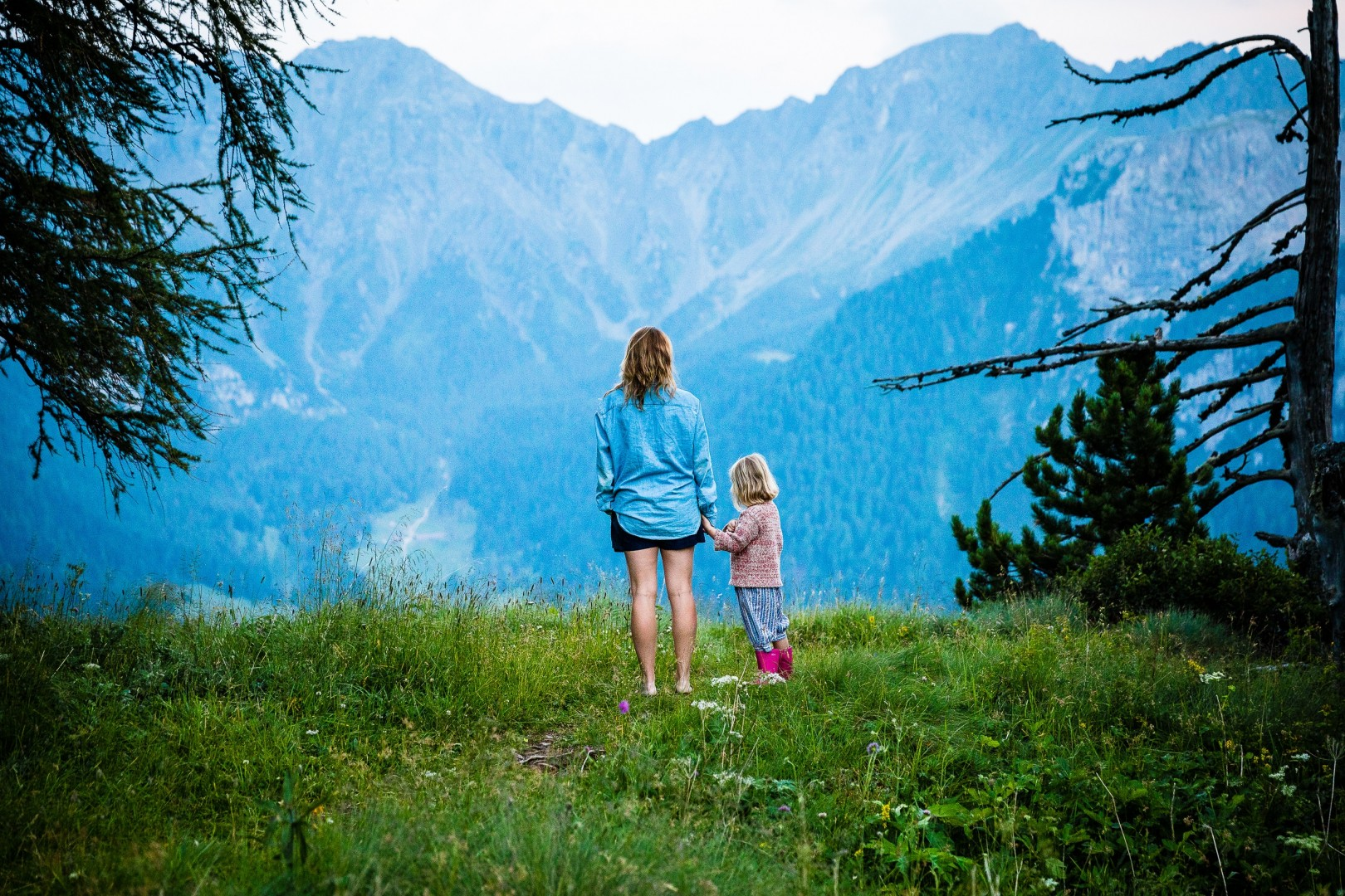 mom and daughter looking at mountains