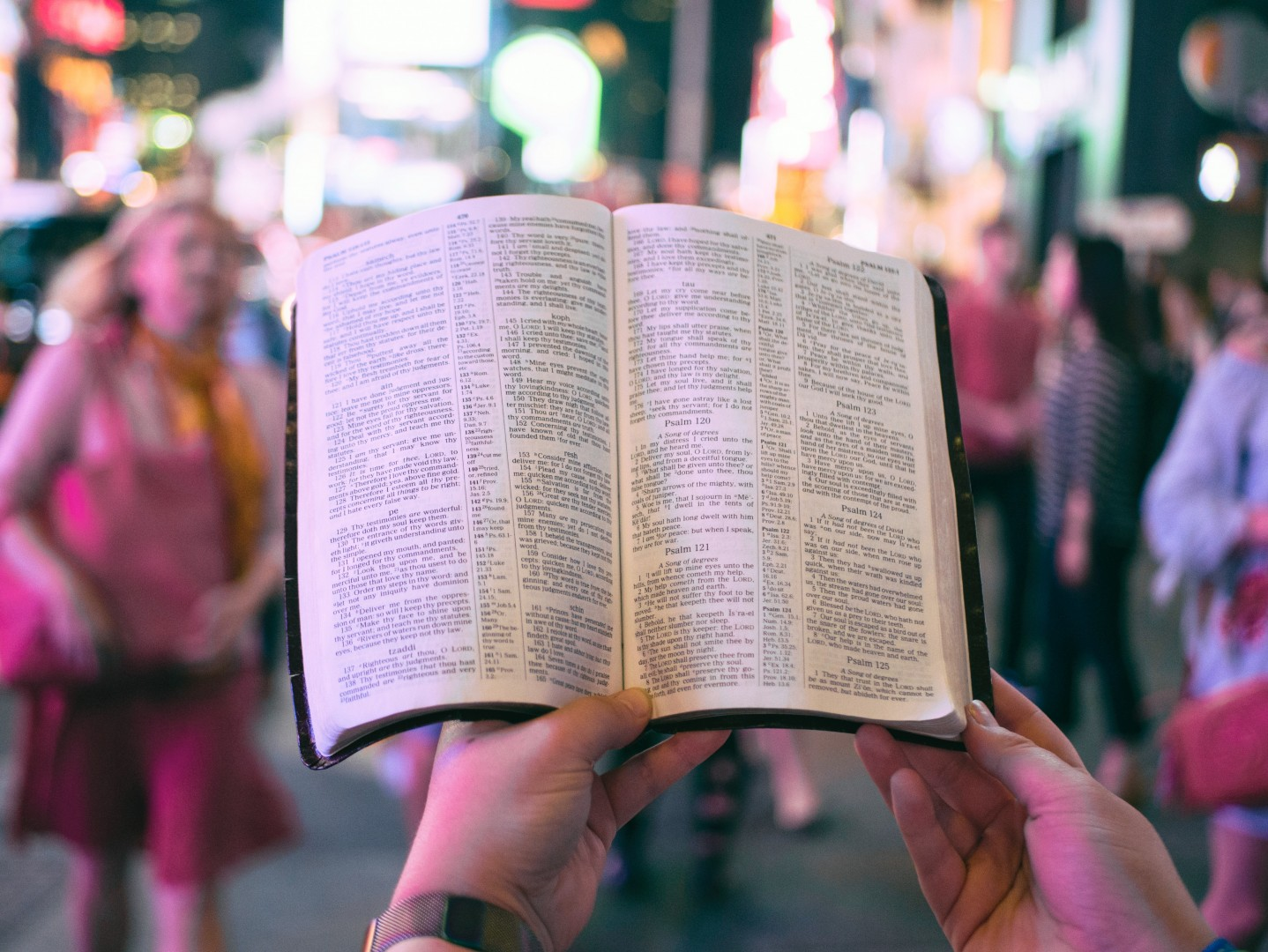 holding bible in crowd