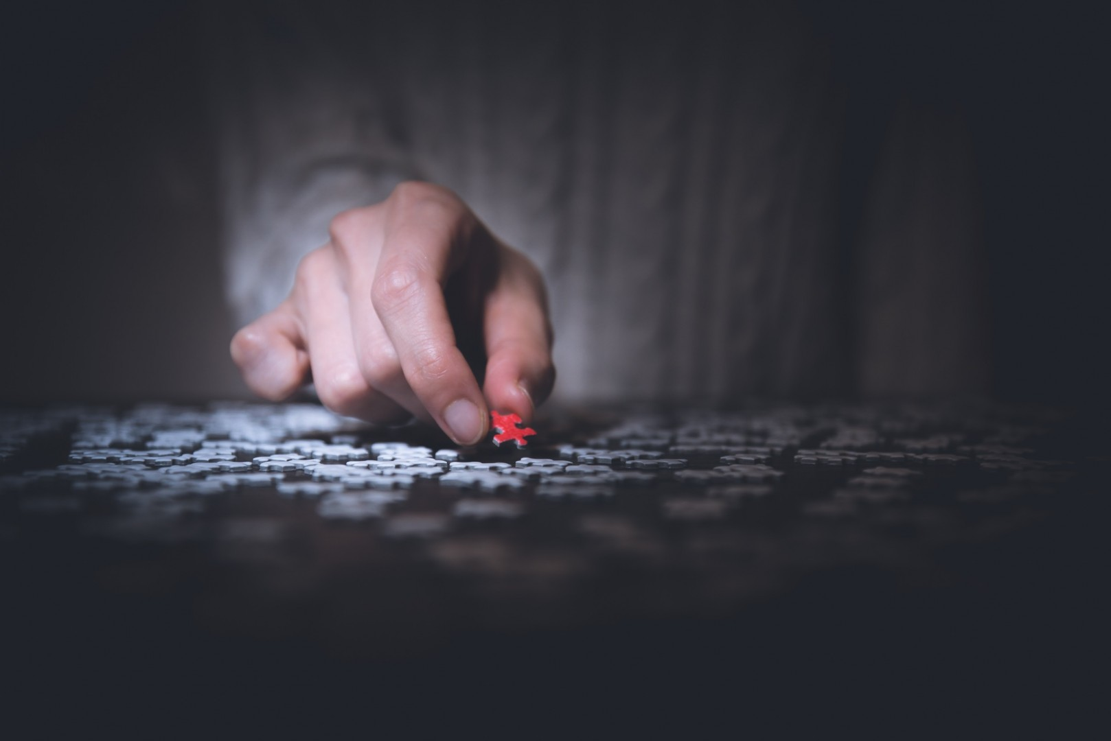 man with puzzle piece