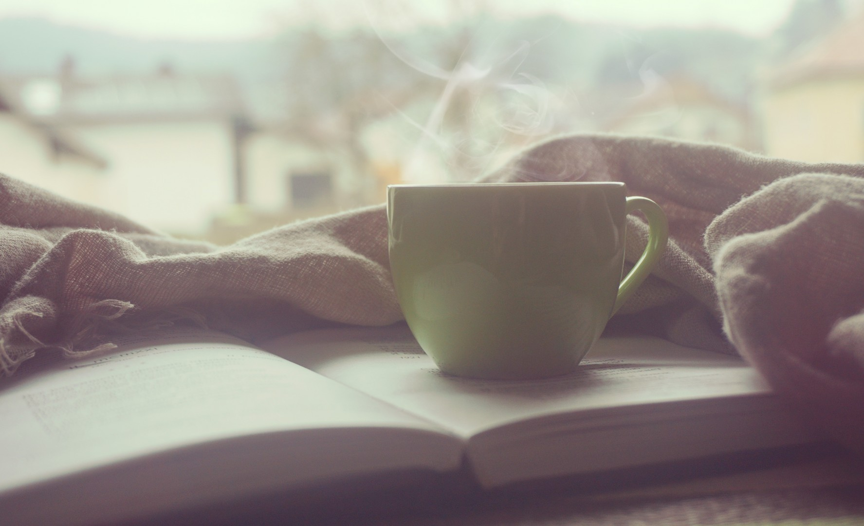steaming coffee cup with bible