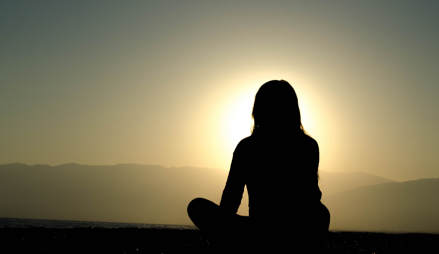 woman sitting against sunset