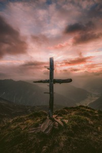 wooden cross with sunset
