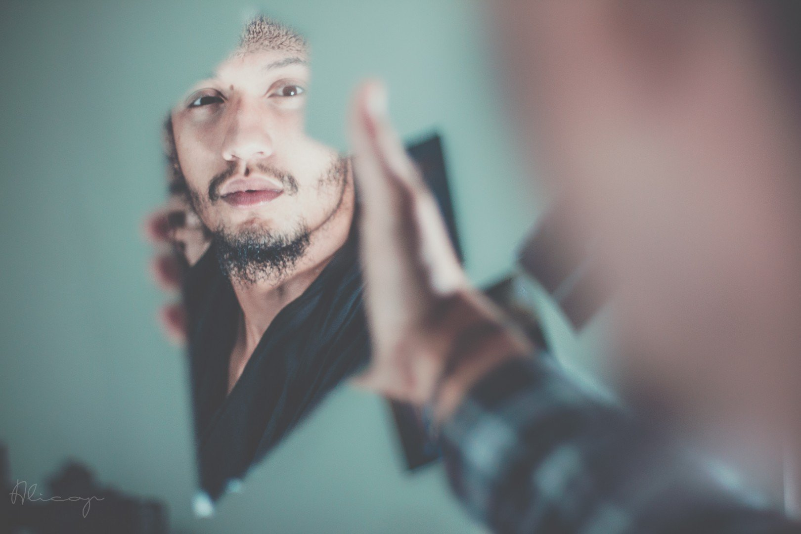 man looking in poor mirror